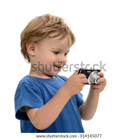 Excited Kid watching his photos on the camera display - stock photo
