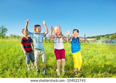 Excited laughing kids group on a summer day - stock photo