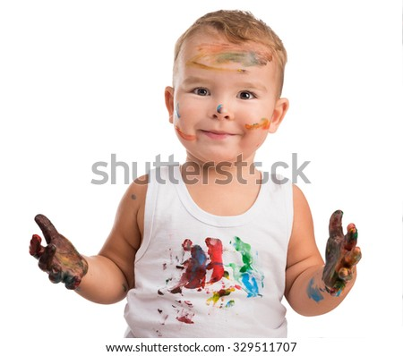 excited little boy with painted face and isolated on a white background - stock photo