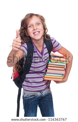 excited little girl holding books and showing thumbs up. isolated on white background - stock photo