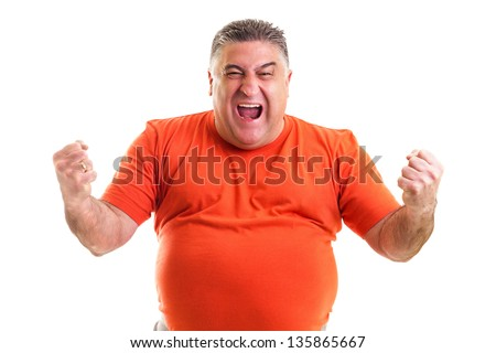Excited  man celebrating success with hands raised against white background - stock photo