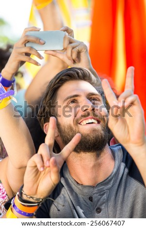 Excited music fan at festival on a summers day - stock photo