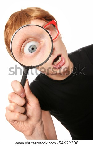 Excited nerd with magnifying glass - stock photo