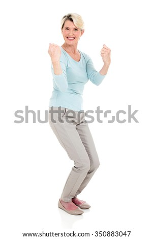 excited senior woman waving fists on white background - stock photo