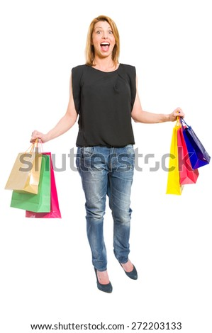 Excited shopping woman acting surprised on white backrgound - stock photo