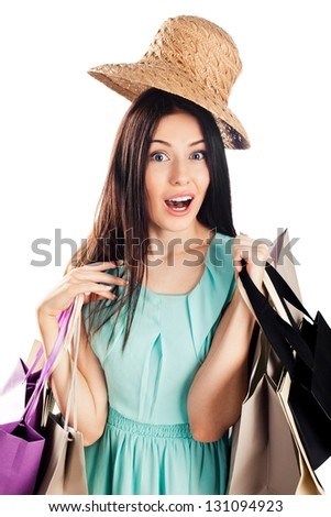 Excited Shopping Woman isolated on white background - stock photo