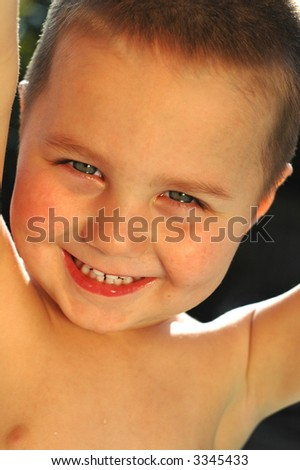 Excited, smiling little boy with an angelic, pure complexion - stock photo