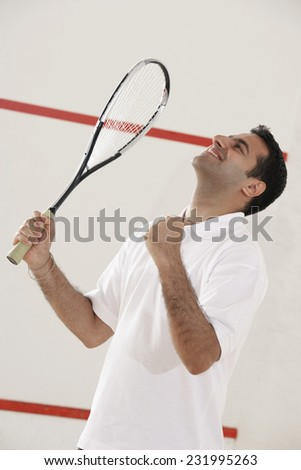 Excited Squash Player - stock photo