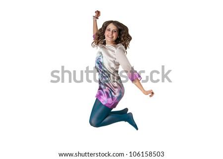 excited stylish female jumping isolated on white background - stock photo