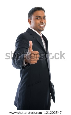 Excited thumb up 30s Indian businessman in black suit isolated on white background - stock photo