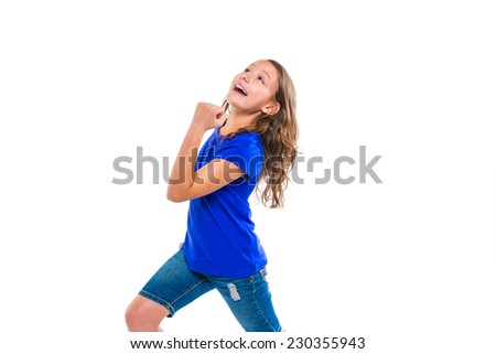 Excited winner expression kid girl gesture running with blue jeans on white background - stock photo