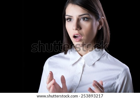 Excited woman looking surprised and amazed,speechless with mouth open.Young woman excited,overwhelmed,shocked, or terrified.Eureka moment concept - stock photo