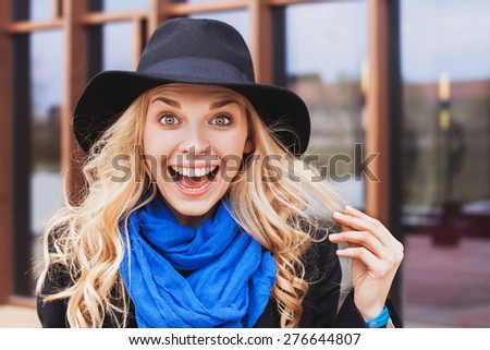 Excited woman portrait - stock photo