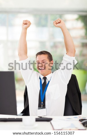excited young businessman closing an important deal - stock photo