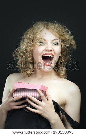 Excited young girl opening surprise gift box  - stock photo