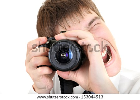 Excited Young Man Take a Picture with a Camera Isolated on the White Background - stock photo