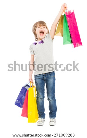 Excited young shopping girl shouting for joy and holding shopping bags on white background - stock photo