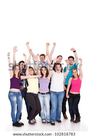 Excited young students with hands raised standing on white background - stock photo