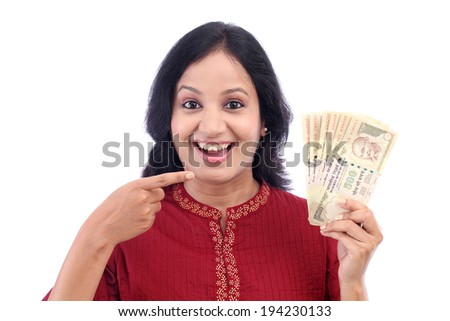 Excited young woman holding five hundred rupee notes against white - stock photo