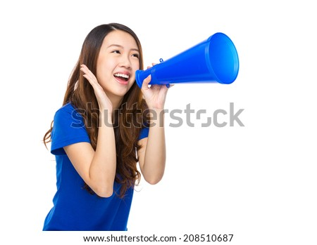 Excited young woman shout with loudspeaker - stock photo