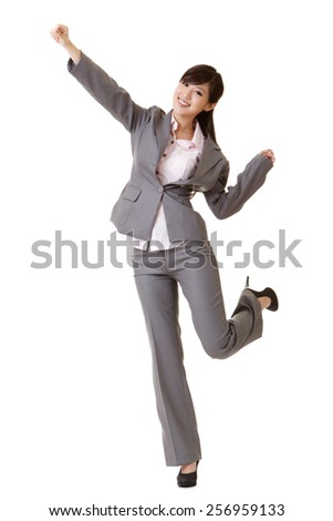 Exciting business woman raising hand, full length portrait isolated on white. - stock photo