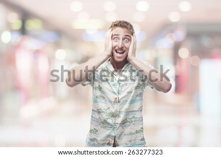 exciting  ginger young man with hawaiian shirt - stock photo