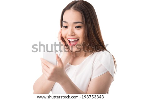 Exciting woman reading text message - stock photo