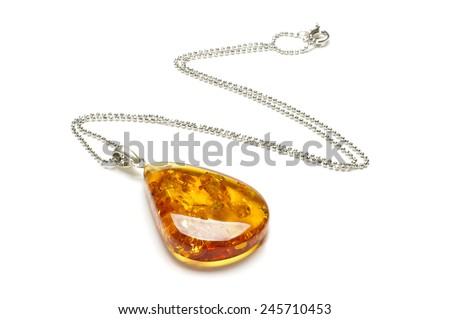 Exclusive amber adornment isolated - stock photo