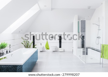 Exclusive bright bathroom with white marble floor and inclined wall - stock photo