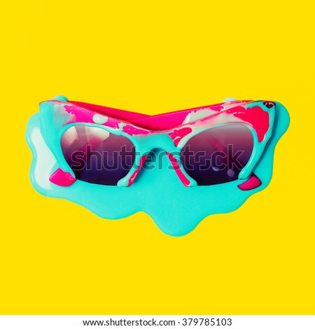 Exclusive Pink Sunglasses dripping blue paint. Explosion Summer Colors - stock photo