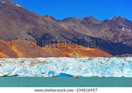 Excursion by boat to the huge white-blue glacier. Unique lake Viedma in Argentine Patagonia. The lake is surrounded by mountains - stock photo