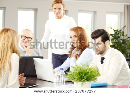 Executive business woman giving advise to sales team while sitting at meeting.  - stock photo