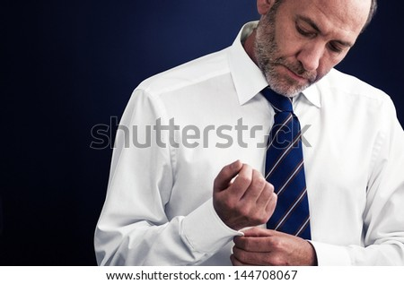executive businessman gets dressed up - stock photo