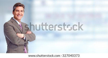 Executive businessman over blue banner background. - stock photo