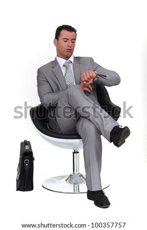 executive checking the time - stock photo