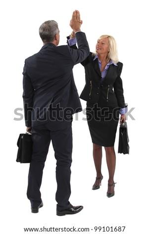 Executive hitting hand - stock photo