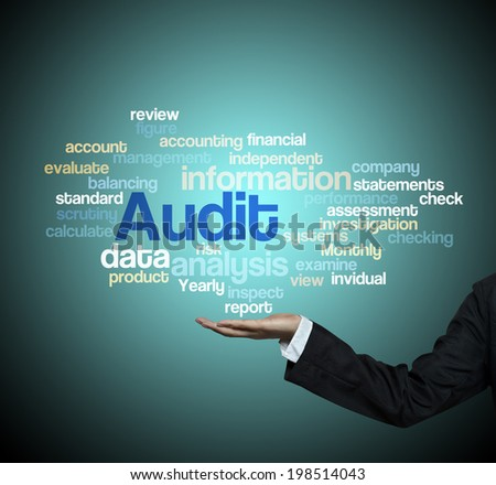 "Executive Holding hand on ""Audit word cloud arrangement"" - stock photo"