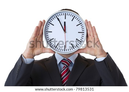 Executive holds clock in front of face as a sign of overload.Isolated on white background. - stock photo