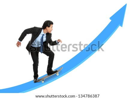 executive on skateboard going up the rising chart isolated over white background - stock photo