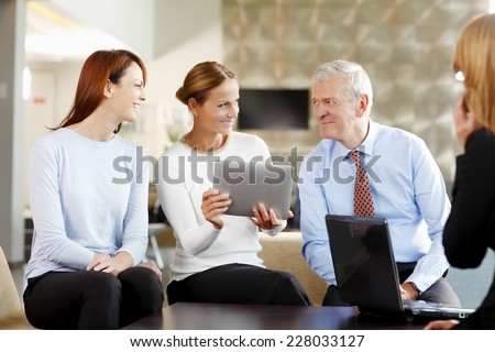 Executive sales woman presenting her idea to her colleagues. Teamwork.  - stock photo