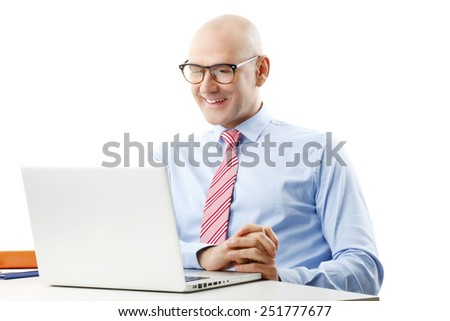 Executive senior financier officer sitting in front of computer and analyzing financial situation. - stock photo