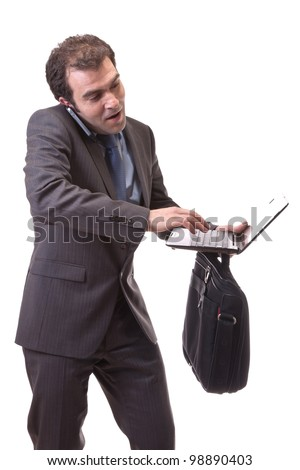 executive struggling with laptop in hand, isolated on white background - stock photo