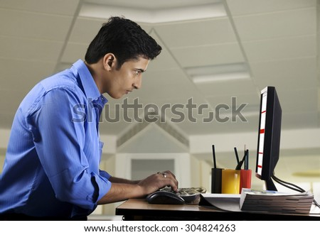 Executive working at his desk - stock photo