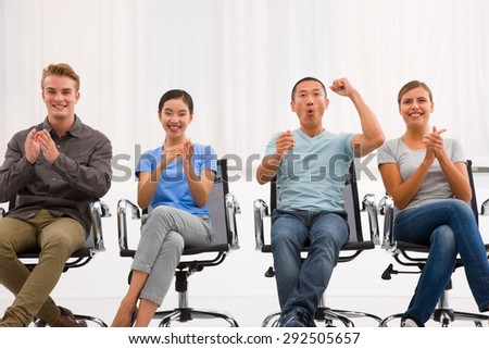 Executives applauding and cheering office - stock photo