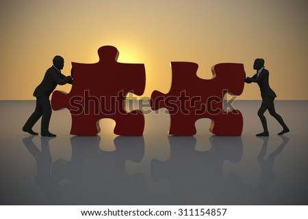 Executives connecting jigsaw puzzle pieces at sunset.Two executives connecting jigsaw puzzle pieces in teamwork at sunset.  - stock photo