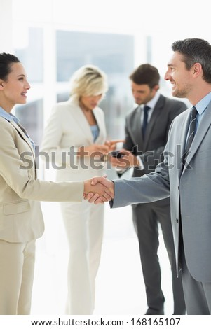 Executives shaking hands after a business meeting in the office - stock photo