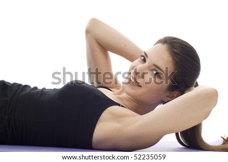 Exercise - A woman in gym clothes, doing sit-ups - stock photo