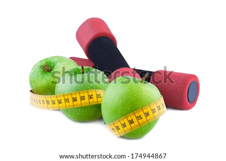 Exercise and healthy diet concept Green apple with Measuring Tape - stock photo