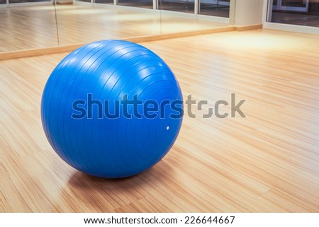exercise ball for fitness on wooden floor - stock photo