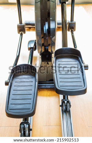 Exercise bicycle in the health club - stock photo